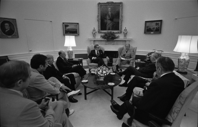 President Gerald R. Ford Meeting with Members of the Commission on Central Intelligence Agency (CIA) Activities within the U.S. in the Oval Office after Receiving Their Report