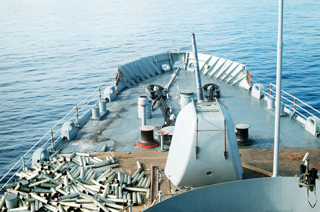 Hundreds of spent shell casings lie in a heap next to the Mark 5-inch/54-caliber gun on the bow of the guided missile ship USS NORTON SOUND (AVM 1), which is conducting underway trials with the gun