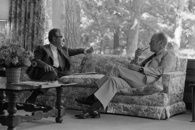 Photograph of President Gerald Ford Meeting with Secretary of State and National Security Adviser Henry Kissinger at Camp David