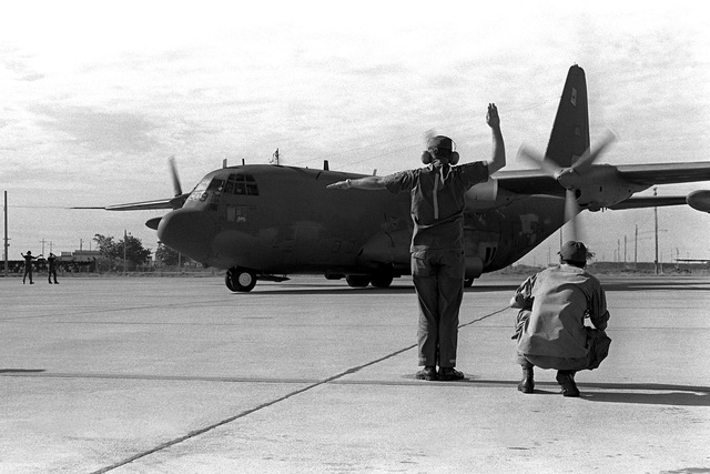A ground crewman directs an AC-130A Hercules aircraft to taxi out. Five remaining AC-130A's of the 16th Special Operations Squadron are being redeployed from Thailand to the United States