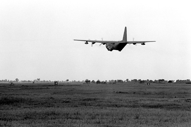 A left rear view of an AC-130A Hercules aircraft taking off. Five remaining AC-130A's of the 16th Special Operations Squadron are being redeployed from Thailand to the United States