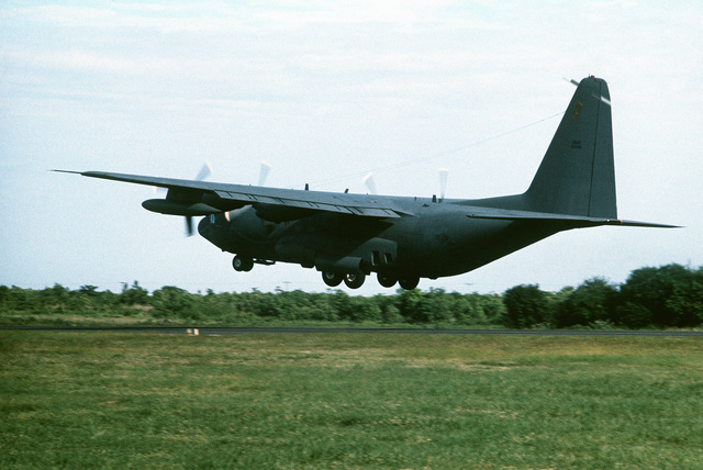 A left rear view of an AC-130A Hercules aircraft taking off. Five remaining AC-130As of the 16th Special Operations Squadron are being redeployed from Thailand to the United States