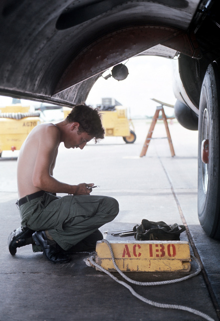 AN airman performs maintenance on an AC-130A Hercules aircraft before takeoff. Five remaining AC-130A Hercules aircraft of the 16th Special Operations Squadron are being redeployed from Thailand to the United States