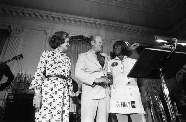 President Gerald R. Ford, First Lady Betty Ford and Comedian Flip Wilson in Character as Geraldine at the White House Staff Reception on the Occasion of the President's 62nd Birthday