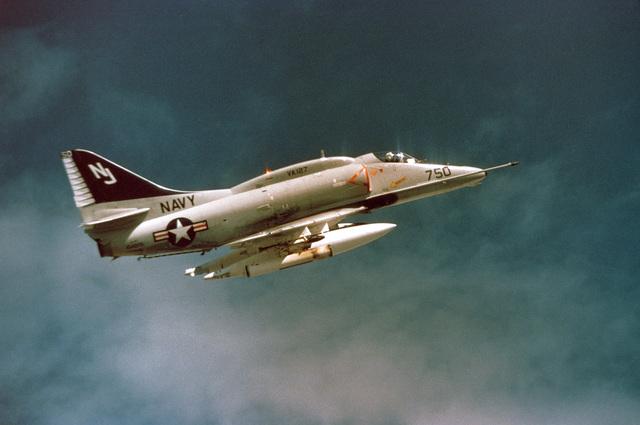 An air-to-air right side view of an Attack Squadron 127 (VA-127) A-4 Skyhawk aircraft