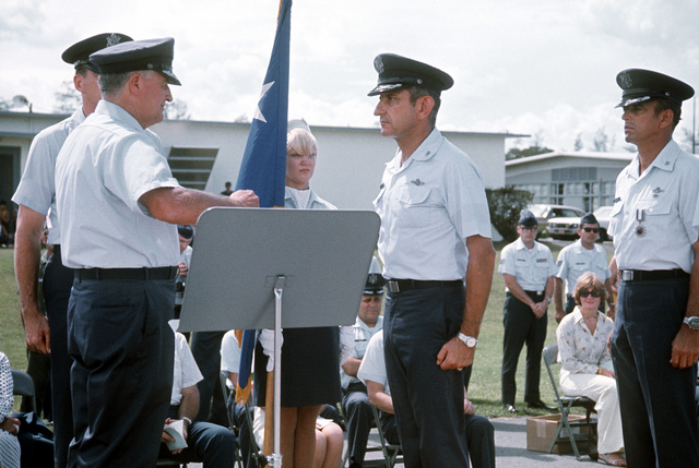 GEN Paul C. Carlton, left, commander, Military Airlift Command (MAC), assigns COL Albert M. Navas, center, as commander, 374th Military Airlift Wing during the change of command ceremony. Just relinquishing command is COL James I. Baginski, right, wearing the Distinguished Service Medal