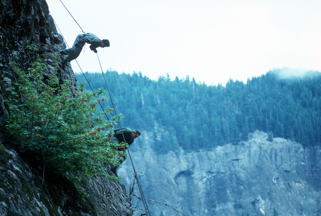 U.S. Army soldiers scale a mountain during a field training exercise