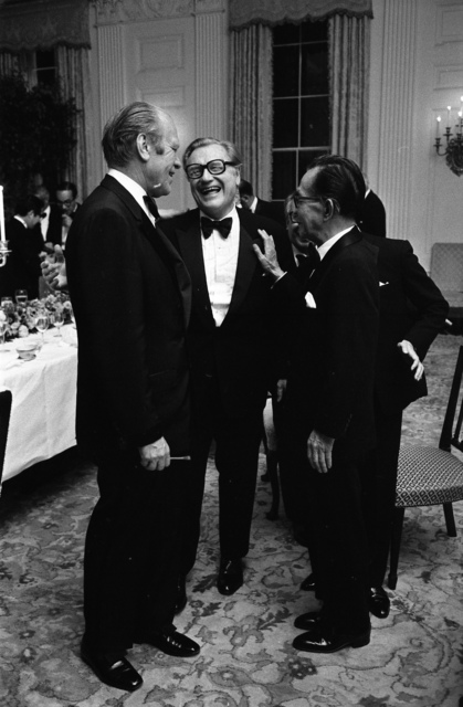 Photograph of Vice President Nelson A. Rockefeller Talking with President Gerald R. Ford and Prime Minister Takeo Miki of Japan at a State Dinner Honoring the Prime Minister of Japan
