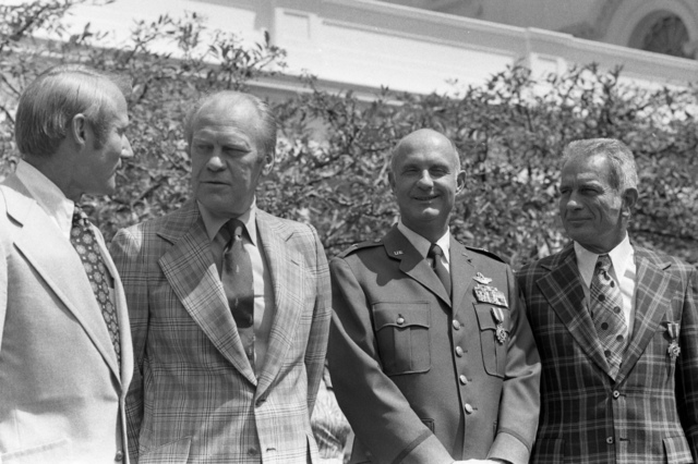 Photograph of President Gerald Ford with Astronauts Vance Brand, Thomas Stafford, and Donald Slayton