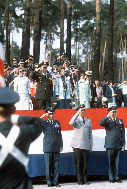 GEN Richard H. Ellis, incoming commander; GEN Ferber, German Air Force; GEN John W. Vogt, outgoing commander; and GEN Alexander Haig, standing above Ellis, pay tribute to the national anthem before the Allied Air Force Central Europe (AAFCE) change of command