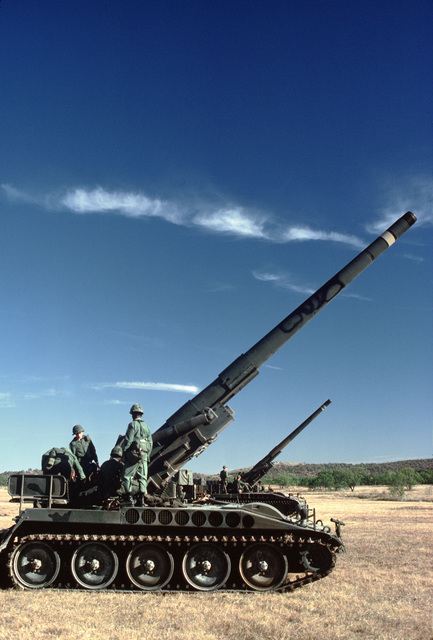 Ammunition is loaded into M107 175 mm self-propelled howitzers during a live-fire exercise