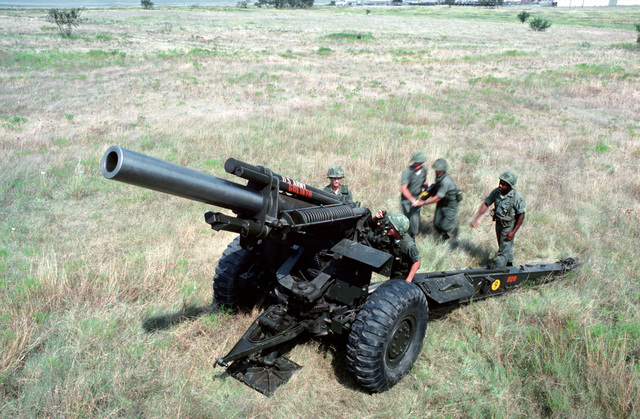 Artillerymen prepare to load an M114A1 155 mm howitzer during a live-fire exercise