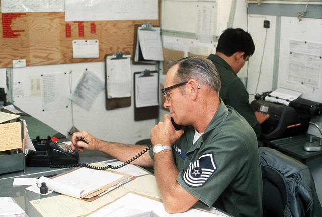 SMSGT Richard Lowe, an aerospace ground equipment/vehicle technician with the 148th Mobile Communication Squadron, uses the telephone in his office. Lowe is working on an Air National Guard (ANG) vehicle acquisition project that he initiated. The project will save the Air Force about seven million dollars
