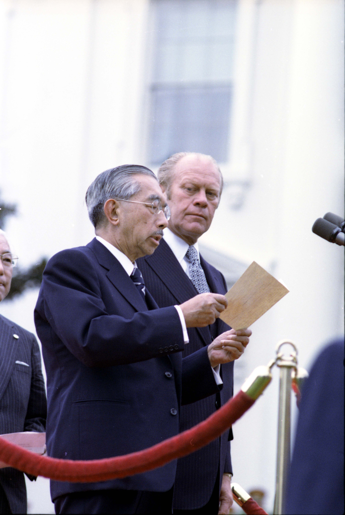 Photograph of Emperor Hirohito of Japan Delivering Remarks at the Arrival Ceremony for His State Visit While President Gerald R. Ford Looks on