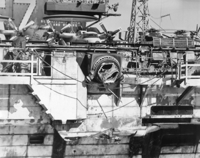 A view of damage sustained by the aircraft carrier USS JOHN F. KENNEDY (CV-67) when it collided with the guided missile cruiser USS BELKNAP (CG-26) during night operations on Nov. 22, 1975