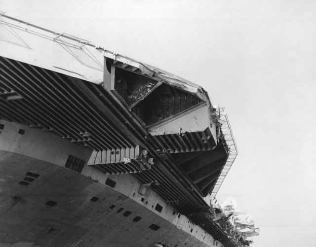 A view of damage sustained by the aircraft carrier USS JOHN F. KENNEDY (CV 67) when it collided with the guided missile cruiser USS BELKNAP (CG 26) during night operations on November 22, 1975