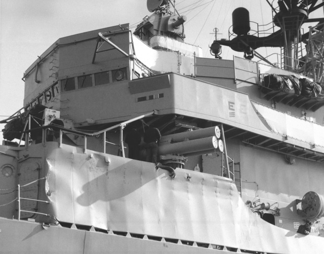 A view of damage sustained by the guided missile destroyer USS CLAUDE V. RICKETTS (DDG 5) while fighting a fire aboard the guided missile cruiser USS BELKNAP (CG 26).  The BELKNAP was heavily damaged and caught fire when it collided with the aircraft carrier USS JOHN F. KENNEDY (CV 67) during night operations on November 22, 1975