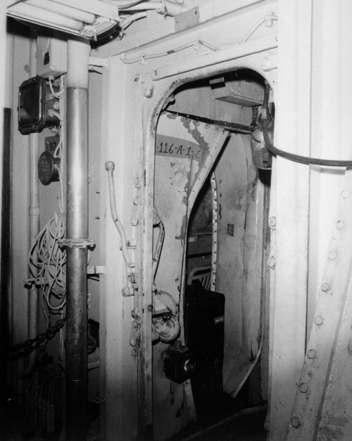 A view of interior damage sustained by the guided missile cruiser USS BELKNAP (CG 26) when the ship collided with the aircraft carrier USS JOHN F. KENNEDY (CV 67) during night operations on November 22, 1975