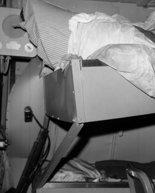 An interior view of damage sustained by the engineering officer's stateroom aboard the guided missile cruiser USS BELKNAP (CG 26).  The BELKNAP was heavily damaged and caught fire when it collided with the aircraft carrier USS JOHN F. KENNEDY (CV 67) during night operations on November 22, 1975