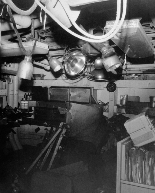 An interior view of damage sustained by the sick bay aboard the guided missile cruiser USS BELKNAP (CG 26).  The BELKNAP was heavily damaged and caught fire when it collided with the aircraft carrier USS JOHN F. KENNEDY (CV 67) during night operations on November 22, 1975