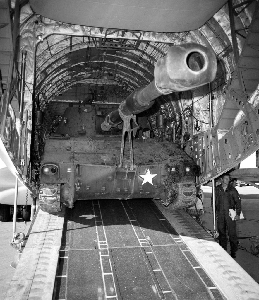 An M-109A1 155mm self-propelled howitzer is offloaded from a YC-15 aircraft during a heavy loading test