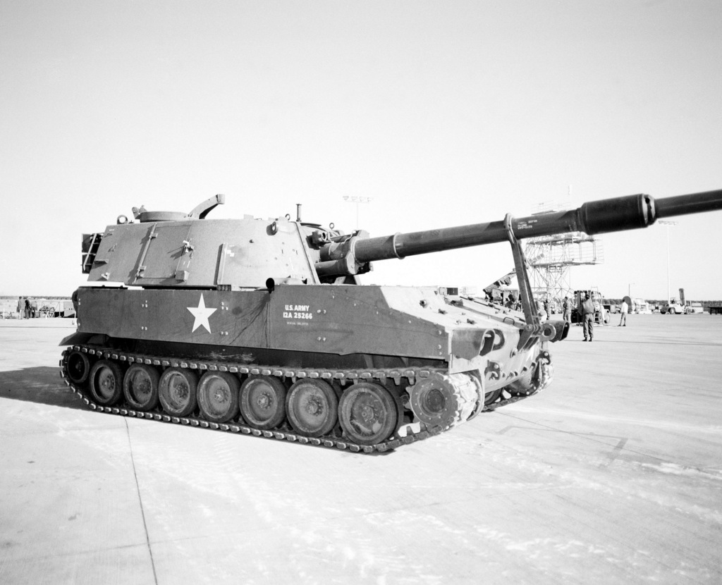 An M-109A1 155mm self-propelled howitzer is parked on the flight line prior being loaded aboard a YC-15 aircraft during a heavy loading test