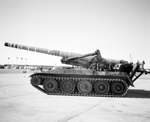 An M-110 203mm self-propelled howitzer is parked on the flight line prior being loaded aboard a YC-15 aircraft during a heavy loading test
