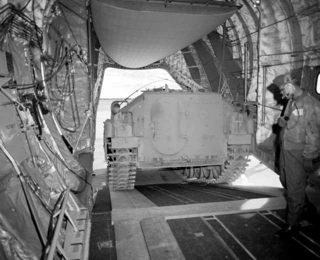 An XM-723 mechanized infantry vehicle is offloaded from a YC-15 aircraft during a heavy loading test
