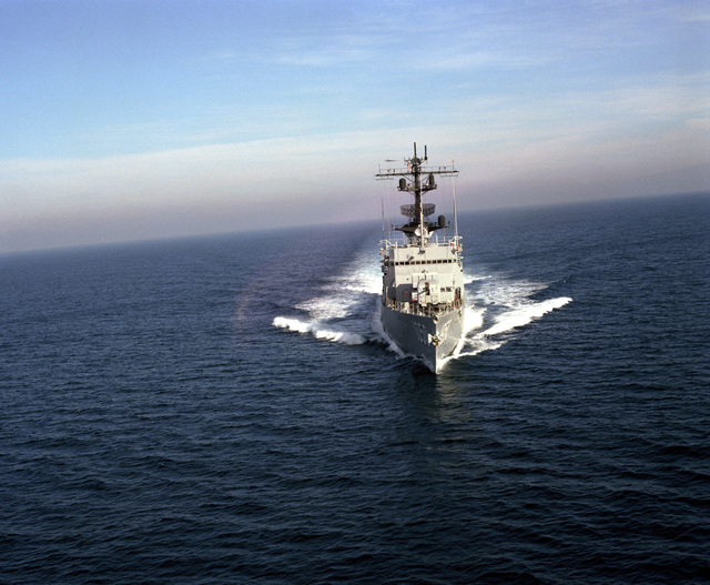 An aerial bow view of the frigate USS ALBERT DAVID (FF 1050) underway off the Southern California coast