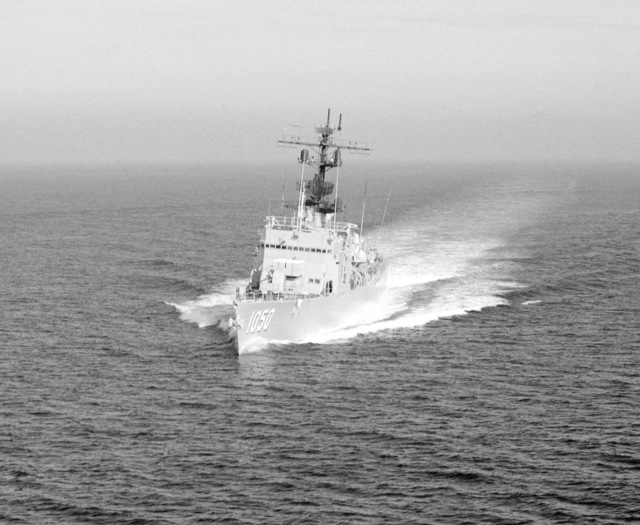 An aerial port bow view of the frigate USS ALBERT DAVID (FF 1050) underway off the Southern California coast