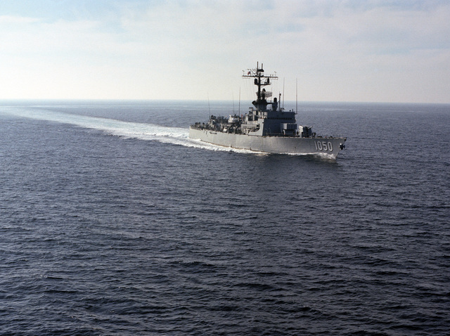 An aerial starboard bow view of the frigate USS ALBERT DAVID (FF 1050) underway off the Southern California coast