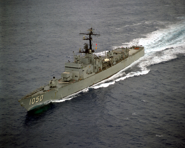 An aerial port bow view of the frigate USS ALBERT DAVID (FF-1050) underway off the Southern California coast