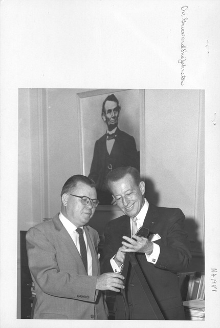 Photograph of Dr. Wayne Grover (Archivist of the United States) and Eric Johnston (Motion Pictures Producer's Association)