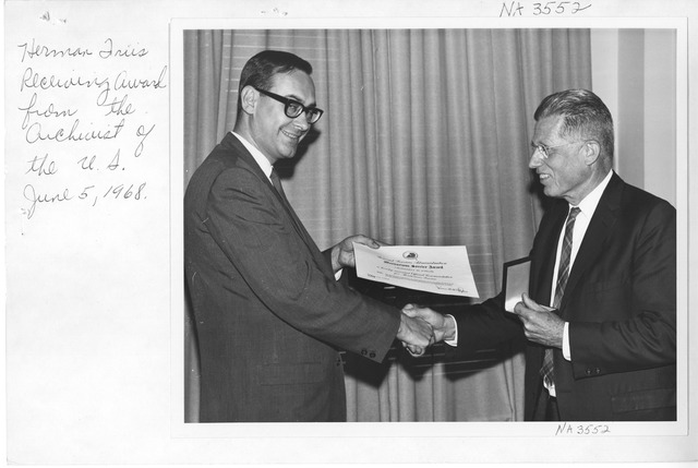 Photograph of Herman Friis Receiving Meritorious Service Award from GSA