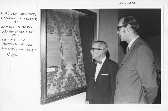 """Photograph of L. Quincy Mumford, Librarian of Congress and James B. Rhoads, Archivist of the U.S. Viewing the """"Printing of the Constitution"""" Exhibit"""