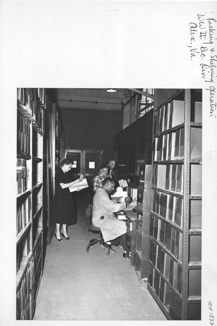 Photograph of Packing and Shelving Operation, World War II Records Division, Alexandria, VA