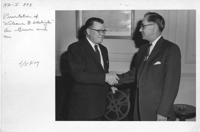 "Photograph of Presentation of ""Welcome to Washington"" Dr. Wayne Grover"