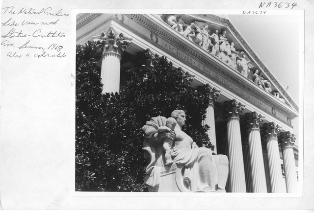 Photograph of The National Archives Side View with a Statue on Constitution Avenue Side