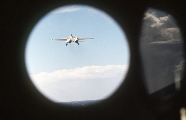 A view of a Fighter Squadron 2 (VF-2) F-14A Tomcat as seen through an open porthole