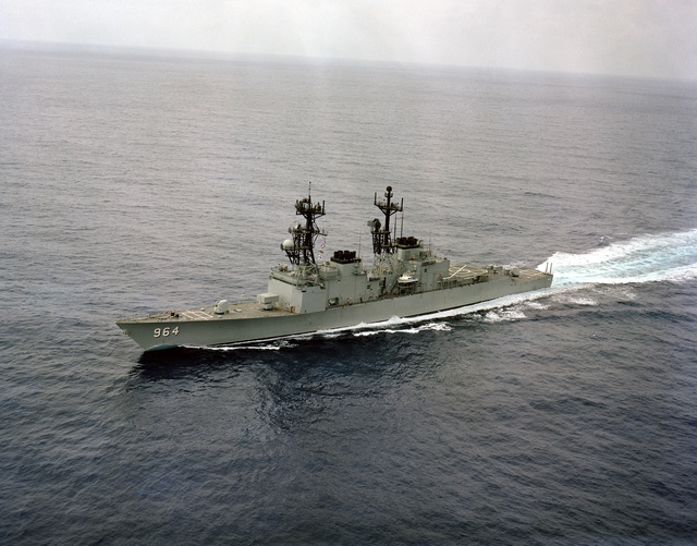 An aerial port bow view of the destroyer USS PAUL F. FOSTER (DD 964) underway off the Southern California coast