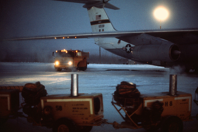 A C-141 Starlifter aircraft is de-iced and refueled during exercise Jack Frost '76. The aircraft is assigned to the 314th Tactical Airlift Wing