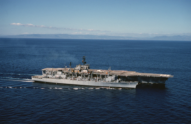 A starboard bow view of the fast combat support ship USS SEATTLE (AOE 3) alongside the aircraft carrier USS AMERICA (CV 66) during an underway replenishment