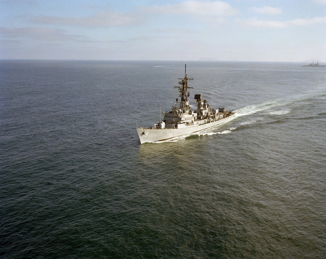 An aerial port bow view of the guided missile destroyer USS TOWERS (DDG 9) underway