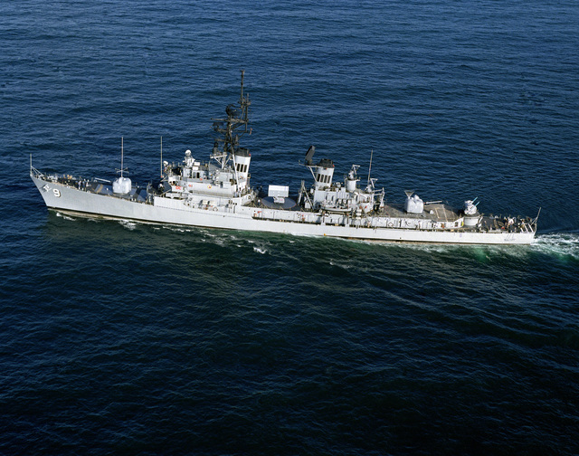 An aerial port view of the guided missile destroyer USS TOWERS (DDG 9) underway
