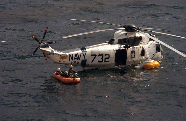 Members of Helicopter Anti-submarine Squadron 6 (HS-6) await rescue from aboard a life raft after they were forced to ditch their SH-3 Sea King helicopter
