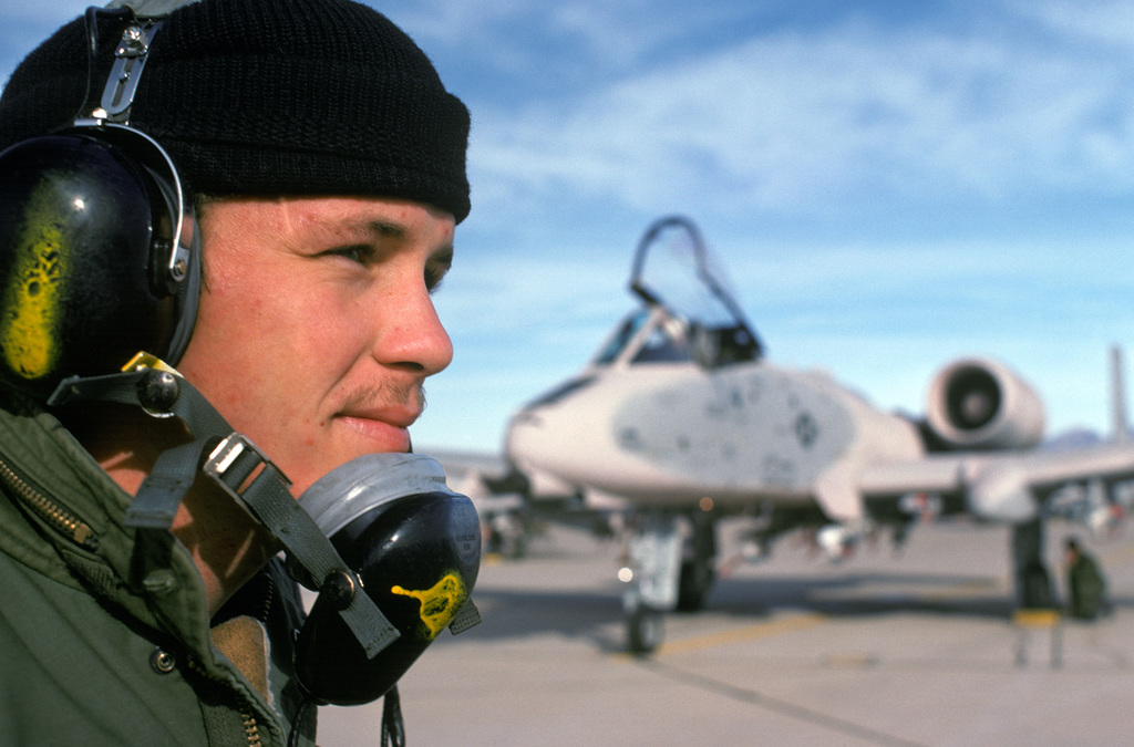 AIRMAN First Class Tony Harper, 355th Maintenance Squadron, stands by to give the all clear sign to an A-10 Thunderbolt II aircraft during a test