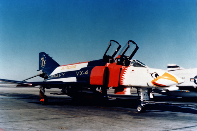 A right front view of an Air Test and Evaluation Squadron 4 (VX-4) F-4 Phantom II aircraft parked on the flight line. The aircraft has been painted in a Bicentennial theme
