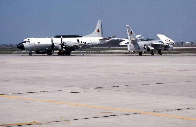 A view of a EP-3B Orion aircraft and an EA-3B Skywarrior aircraft parked on the flight line. Both aircraft are assigned to Fleet Air Reconnaissance Squadron 2 (VQ-2)