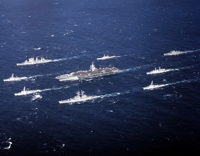 An aerial port bow view of ships involved in a joint operation