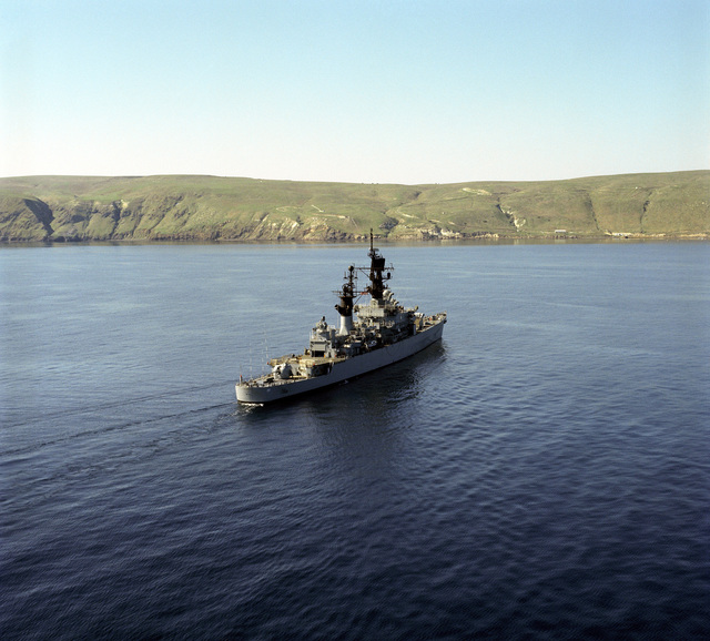 An aerial starboard quarter view of the guided missile cruiser USS JOUETT (CG 29) underway near San Clemente Island